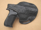 Dedicated holsters are uncommon, but a little searching may yield a workable solution from a more popular platform for concealed or trail carry.