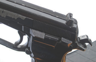 Controls are well laid out for most shooters. Slide release and thumb safety fall easily under shooter's thumb but are placed where they are not accidentally engaged with a high thumb grip.