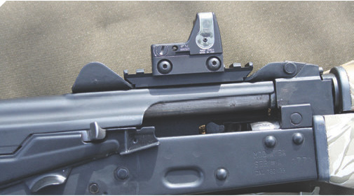 StormWerkz scope mount was drilled and tapped into Yugo AK SBR's top cover. Trijicon RMR was chosen for Yugo based on its lack of reliance on battery power and compact size.
