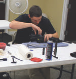 Author works on his Wilson Combat AR-15 during classroom portion of Carbine Fundamentals course.