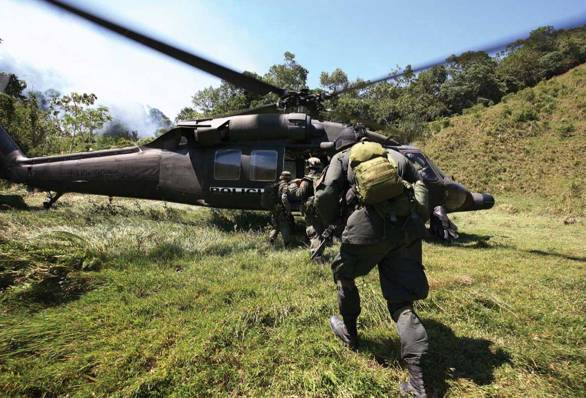Jungla forces scramble to reboard Blackhawk after blowing HCL lab. Sitting on LZ is most dangerous part of any mission, due to sniper fire and attack by enemy forces.