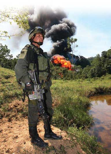 Jungla operator keeps an eye on the LZ as HCL lab explodes.