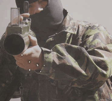 High contrast of lightcolored hands and dark rocket muzzle serves as more distinct aiming point than actual muted vitals, and pulls shots in.