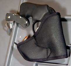 Tuff Products Pock-A-Roo combo pocket holster and ammo pouch. Strip shown at rear of holster is special fiveshot .38/.357 strip.