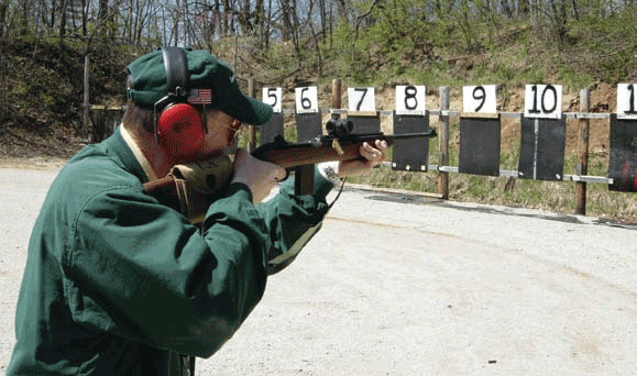 Kelly with Auto-Ordnance carbine with Aimpoint T-1 on multiple target drills. Note ejecting case and virtually no recoil of carbine. Gun is fast for repeat shots due to lack of perceived recoil.