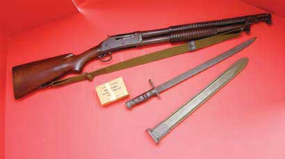 M97 trench gun with sling, bayonet, and brass M19 00 buckshot loads.