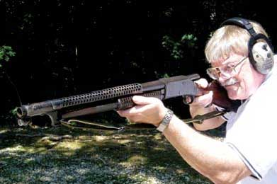 Thompson shoots M97 trench gun with distinctive handguard. Bolt comes out of rear of receiver when slide is operated.
