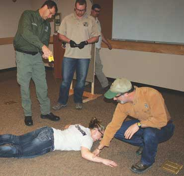 Lemhi County, Idaho Sheriff's Deputy Teresa Stephenson experiences an exposure by Taser Master Instructor Tom Munsey. Exposure was made with Deputy Stephenson already on the ground. There was no chance of injury from falling.