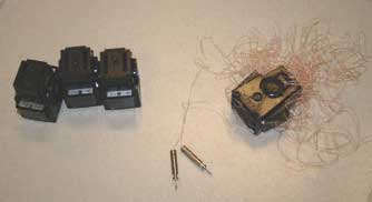 Three charged and one discharged X26 cartridges. Once cartridge is removed from device and probes from the Tasee, it can be rolled up and either disposed of or booked into evidence.