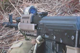 Aimpoint T-1 is mounted directly to rail's top cover, providing visibility of iron sights in lower third of optic's view.