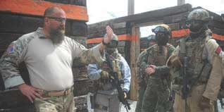 EAG Tactical Instructor John Chapman reviews team's actions in the house during force-on-force training. Mistakes should be learned from but not obsessed over. Instead, form a positive image of how the correct action should be performed the next time, and mentally repeat that image. A more successful result is likely to be produced in this manner.