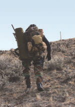 Unlike his urban counterpart, rural sniper must carry everything he may possibly need with him, and hike into the objective.