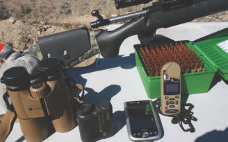 Spotting scope, quality binoculars, rangefinder, PDA, and weather station are some of the tools author practices with and carries in his pack.