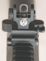 Flip-up adjustable Samson rear sight features Ruger marking.