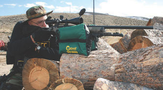 Caldwell Tack Driver on the woodpile. These bags level up uneven platforms in a pinch.