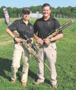 Melissa Gilliland cradles Saber Enhanced Factory Remington 700, .22-250 caliber rifle. Her husband Jim holds Saber RLA-A3 modular rifle chassis for Rem 700 .308 Win.