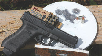 Glock 17 was used as a control for the tests, shown here with its group on the 20-yard plate.