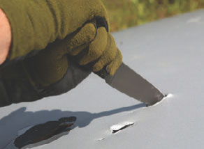 Using WK II Striker's hammer pole as a pounding surface helps make controlled penetration cuts in materials without user discomfort. Blade was unaffected by repeated stabs into the hood of a car.
