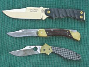 Author prefers Bowie-type blades. Top to bottom: TOPS Team Jackal Survivor, Schrade Bear Paw, and Spyderco Schempp Bowie.