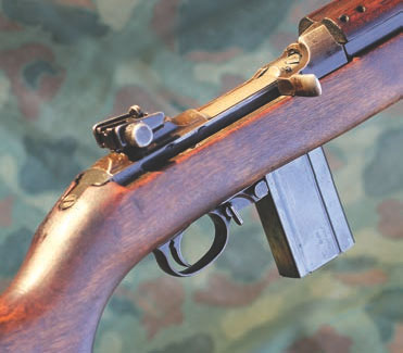 M1 Carbine's controls are well laid out for the shooter. Rotary safety is quickly disengaged by a swipe of the trigger finger while mounting the gun. Open-top design is easily manipulated by most.