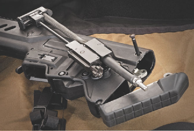 By pushing out captive takedown pin and rotating butt pad downward, the piston, recoil spring and bolt carrier group are simply pulled from the rear of the carbine.