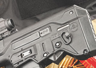 Tavor incorporates sockets for sling swivels. Bolt release is located under captive takedown pins.